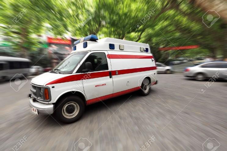 11481745-ambulance-speeding-on-the-street-Stock-Photo-ambulance-emergency-car